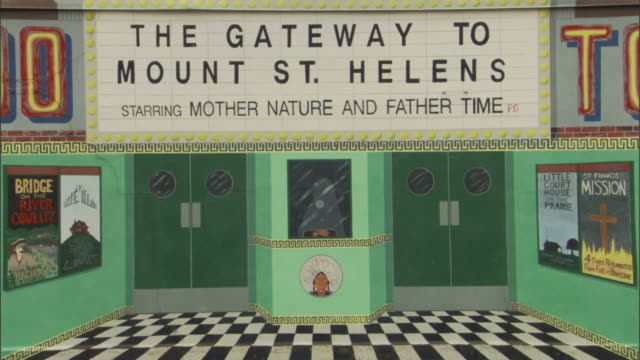 a mural advertises the gateway to mount st. helen's in washington. - theatre banner commercial sign stock videos & royalty-free footage