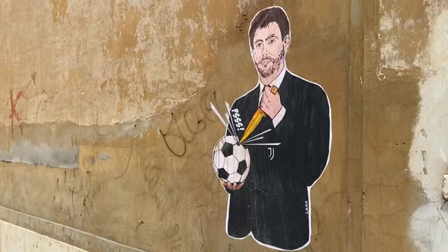 stockvideo's en b-roll-footage met mural artist in rome drew picture of juventus chairman andrea agnelli on a wall behind the headquarters of italian football association in protest... - english football association
