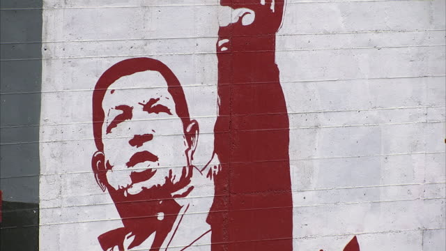 cu zo ws mural by highway depicting hugo chavez and words working with people must be beginning of every revolutionary / metropolitan district of caracas, miranda, venezuela - socialism stock videos & royalty-free footage