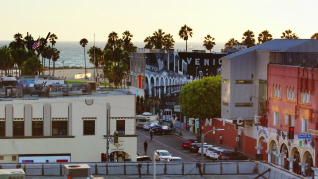 mural clad buildings in venice, california - street name sign stock-videos und b-roll-filmmaterial