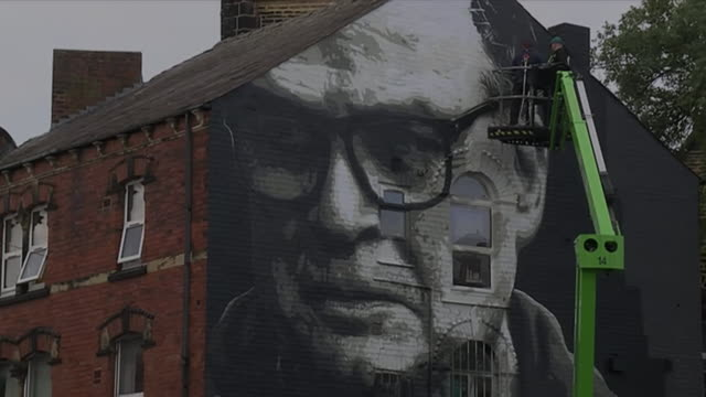 mural depicting leeds united manager marcelo bielsa being painted onto the side of a house - paintings stock videos & royalty-free footage