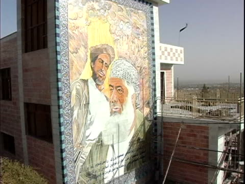 mural depicting middle eastern men on wall in city / afghanistan - male likeness stock videos & royalty-free footage