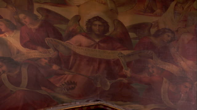 A mural depicts angels in a scene from the Bible. Available in HD.