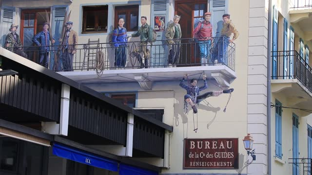 mural depicts famous mountain guides including gaston rebuffat at the famous winter sports resort of chamonix located at the foot of the mont blanc... - ski resort stock videos & royalty-free footage
