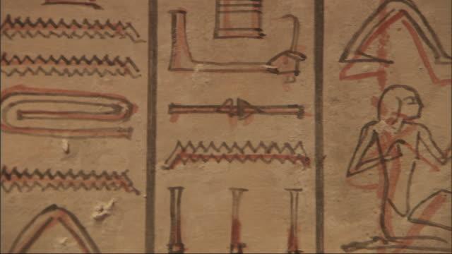a mural depicts hieroglyphics. - geroglifico video stock e b–roll