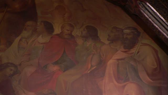 a mural depicts the apostles listening attentively. available in hd. - apostel bildbanksvideor och videomaterial från bakom kulisserna