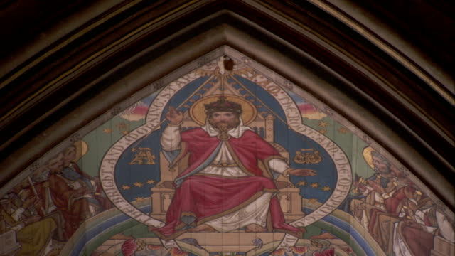 A mural in Ely Cathedral depicts a king upon his throne. Available in HD.