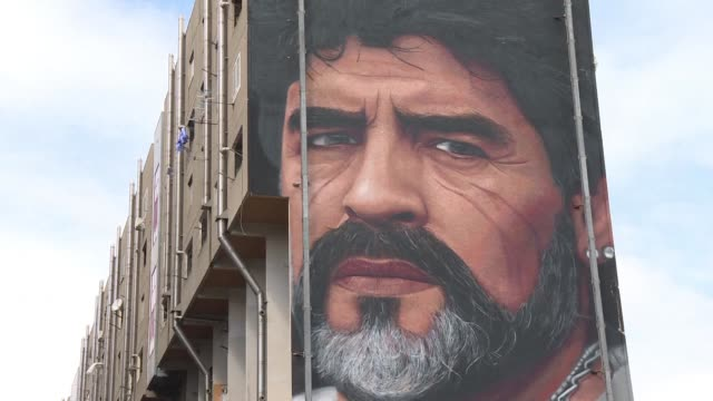 A mural of Argentinian football superstar Diego Armando Maradona who played for Napoli Football club for many years is painted on the side of a...