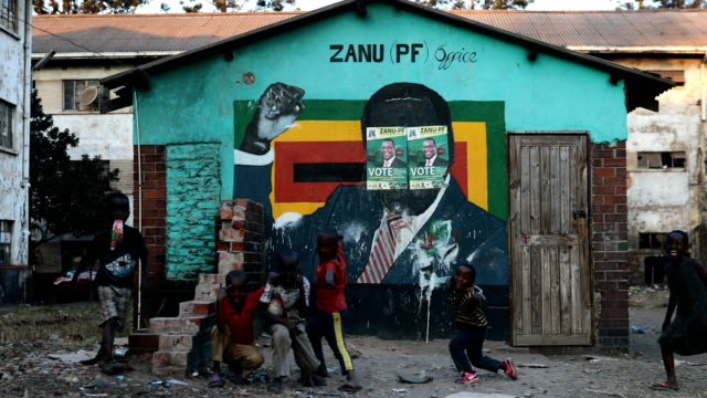 a mural of former zimbabwean president robert mugabe on july 29 2018 in harare zimbabwe zimbabweans go to the polls on july 30th to vote for a new... - zimbabwe stock videos & royalty-free footage