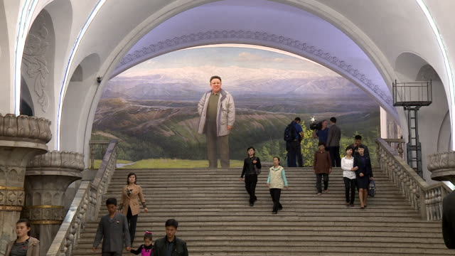 a mural of kim jongil decorates a subway station in pyongyang - propaganda stock-videos und b-roll-filmmaterial