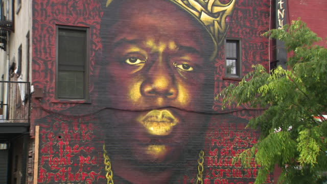 a mural of the biggie smalls in brooklyn has garnered new attention lately as the building's landlord threatened to remove it - biggie smalls stock videos and b-roll footage