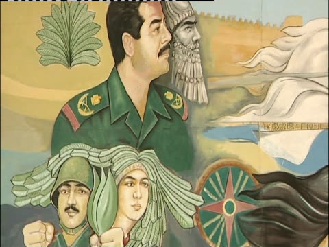 a mural on a billboard depicts iraqi government. - saddam hussein stock videos and b-roll footage