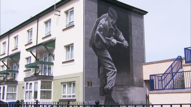 mural on house wall, derry, northern ireland - northern ireland stock videos & royalty-free footage