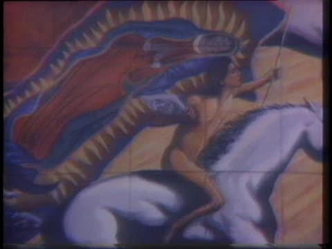 muralist john gonzalez explains the symbolism of a public mural. - 1976 stock videos & royalty-free footage