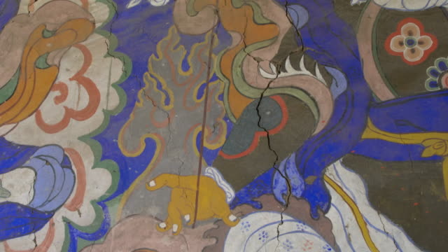 murals and paintings on a wall inside thiksay monastery, ladakh, india - mural stock videos & royalty-free footage