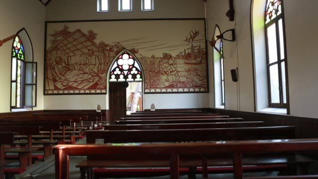 Murals of Angelo da Fonseca in St Xavier's Church in Pune India at the walls of the church