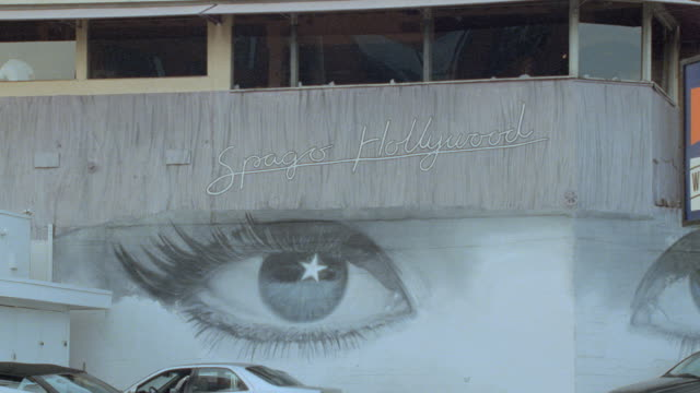 murals of eyes adorn the exterior wall of a building across from tower records in hollywood. - tower records stock videos & royalty-free footage