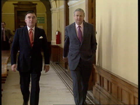 Murder Catholic / CrossParty talks INT LMS Sir Patrick Mayhew along corridor towards with Michael Mates MP PULL OUT CMS Mayhew and Mates into pkf PAN...