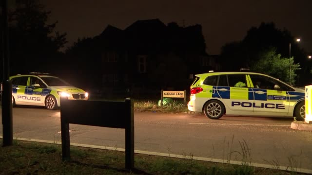 murder investigation begins after two bodies found in north west london park 05/ london kingsbury police cars parked outside houses police officer... - crime and murder stock-videos und b-roll-filmmaterial