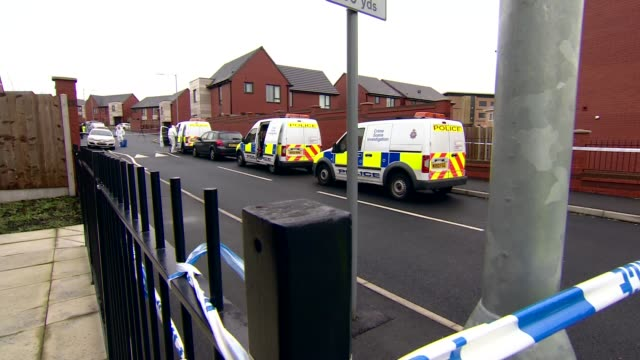 murder investigation launched after man found stabbed in bolton england greater manchester bolton breightmet ext police cordon tape around fence and... - bolton greater manchester stock videos and b-roll footage
