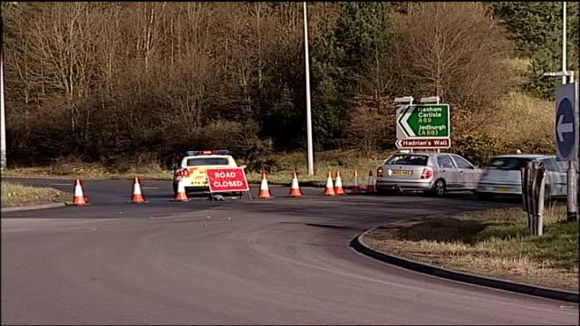 PC Joe Carroll killed in car crash ENGLAND Northumberland Corbridge A69 EXT Long shots Police investigators along beside overturned police car of PC...