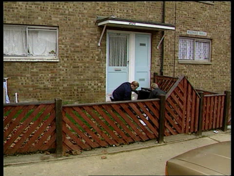 murdered boy; england peterborough welland estate lms police searching dustbins on housing estate zoom in one taking items from dustbin and putting... - at the edge of stock videos & royalty-free footage