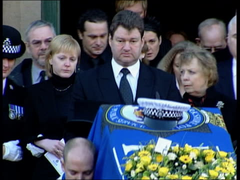 murdered pc ian broadhurst funeral held itn eilisa towards from church behind coffin as bagpipes playing sot police officers standing outside church... - pc ian broadhurst stock videos & royalty-free footage
