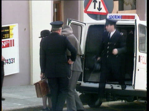 murderer sentenced to death; isle of man douglas bv tony teare out of van with police as covered with blanket & into court l-r zoom in - isle of man stock videos & royalty-free footage