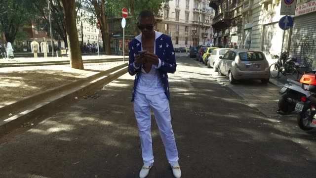 Murphy Osayande wearing a Chanel shirt and jacket Herman Sons trousers and Versace shoes is seen during Milan Men's Fashion Week Spring/Summer 2018...