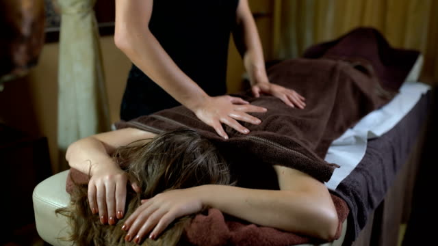 muscle relaxation - massage table stock videos & royalty-free footage