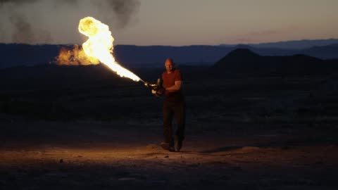 a muscled man runs and shoots a flamethrower - completely bald stock videos & royalty-free footage