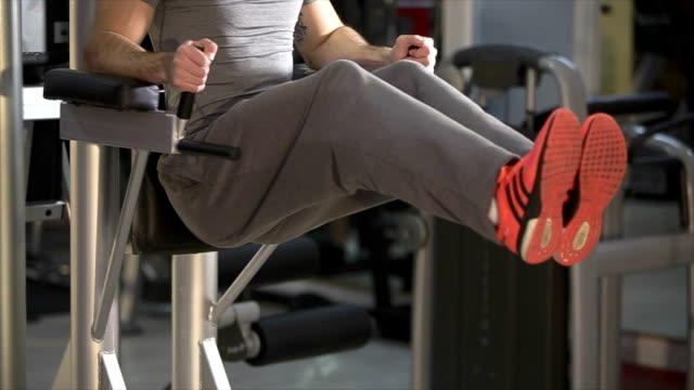 Muscular athlete doing abdomen exercises