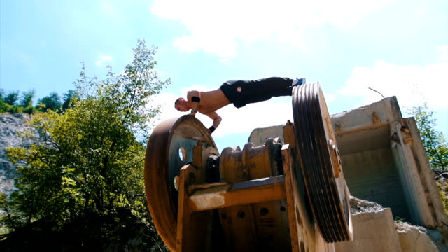 muscular athlete doing push ups on the machinery slowmotion - tracksuit bottoms stock videos & royalty-free footage
