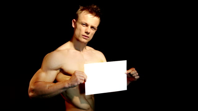 muscular man holding a white blank board