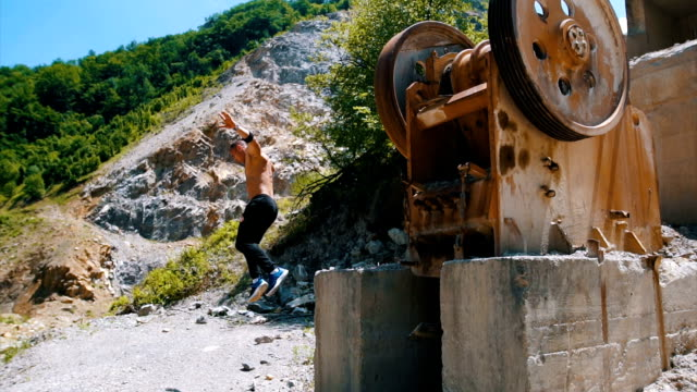 muscular man jumping from the machinery - tracksuit bottoms stock videos & royalty-free footage