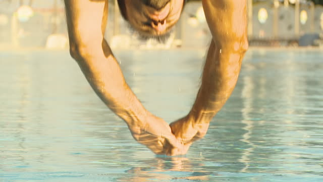 HD SLOW MOTION: Muscular Man Jumping Into Pool