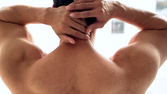 muscular man suffering from neck pain. incorrect sitting posture problems muscle spasm, rheumatism. pain relief, chiropractic concept. sports exercising injury. - neck stock videos & royalty-free footage