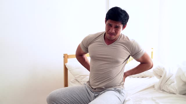 Muscular Man suffering from neck pain. Incorrect sitting posture problems Muscle spasm, rheumatism. Pain relief, chiropractic concept. Sports exercising injury.