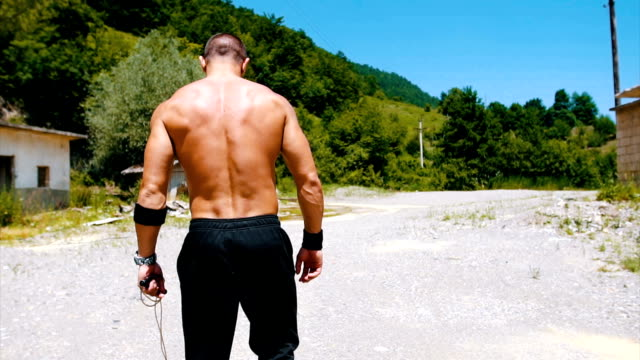 muscular man walking in the nature - bodyweight training stock videos & royalty-free footage