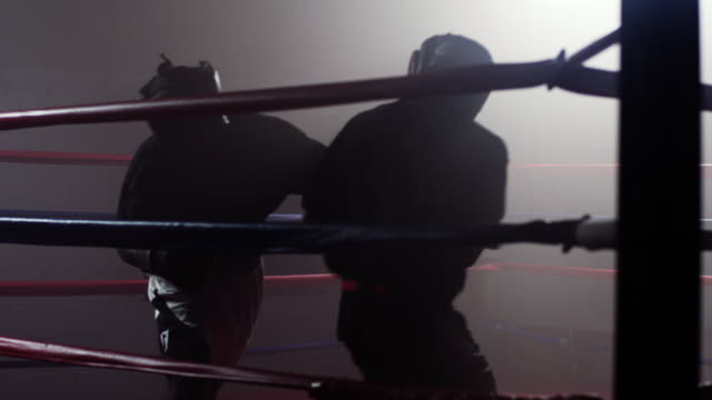 Two boxers train in a sparring match.