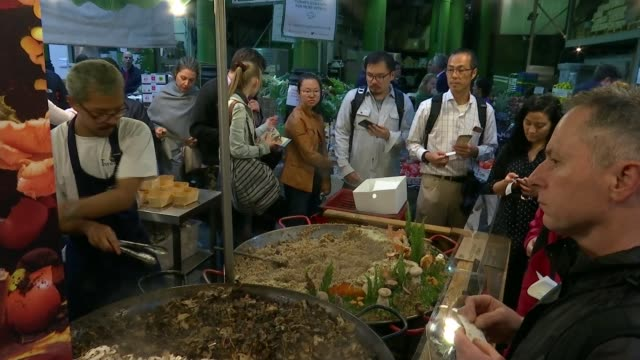 va museum exhibit promoting sustainable food product growth england london borough market ext close shot of reporter mushroom risotto being prepared... - risotto stock videos & royalty-free footage