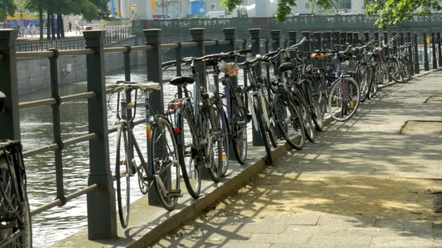 museum island, bikes by the river spree - river spree stock videos & royalty-free footage