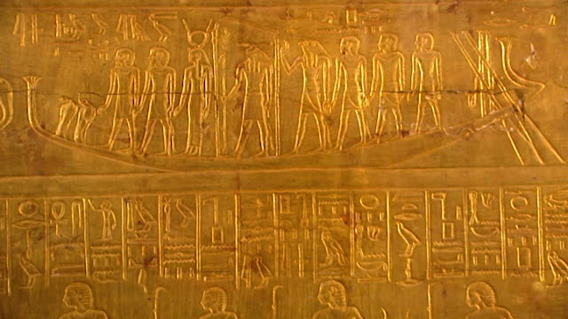 museum of cairo. view of a gilded shrine panel from the tomb of tutankhamun. - ancient stock videos & royalty-free footage