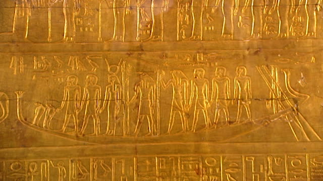 museum of cairo. view of a gilded shrine panel from the tomb of tutankhamun. - metal stock videos & royalty-free footage