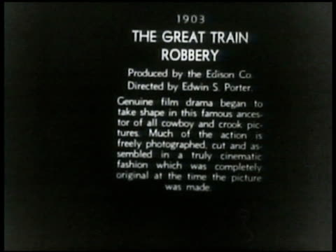 MOMA Museum of Modern Art film vault male filing film can w/ others on shelf Clip from 'the Great Train Robbery' by Thomas A Edison 1903