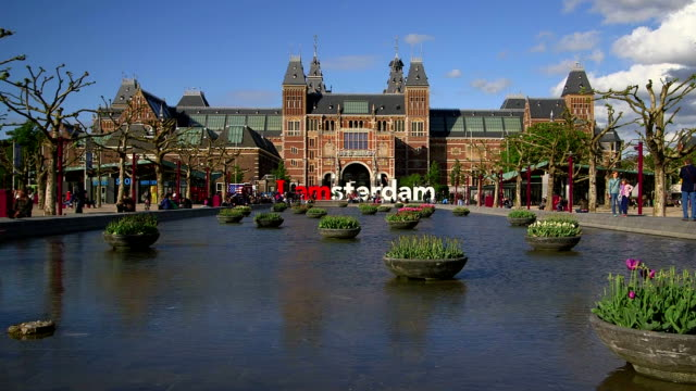 museumplein with rijksmuseum, amsterdam, the netherlands - western script stock videos & royalty-free footage