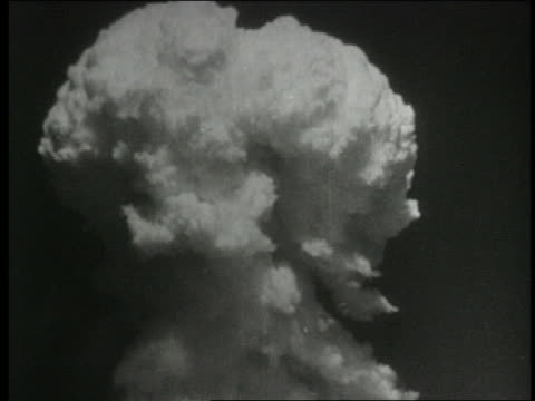 b/w 1954 mushroom cloud after atom bomb explosion over pacific - atomic bomb testing stock videos & royalty-free footage
