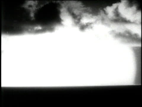 a mushroom cloud explodes in the sky over hiroshima japan in 1945 - atomic bomb stock videos & royalty-free footage