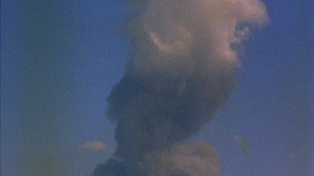 cu tu mushroom cloud formed after nuclear explosion - hydrogen bomb stock videos and b-roll footage