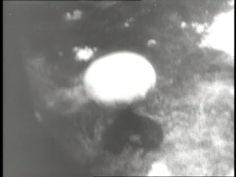 a mushroom cloud rises after an atomic bomb hits hiroshima japan - 1945 stock-videos und b-roll-filmmaterial